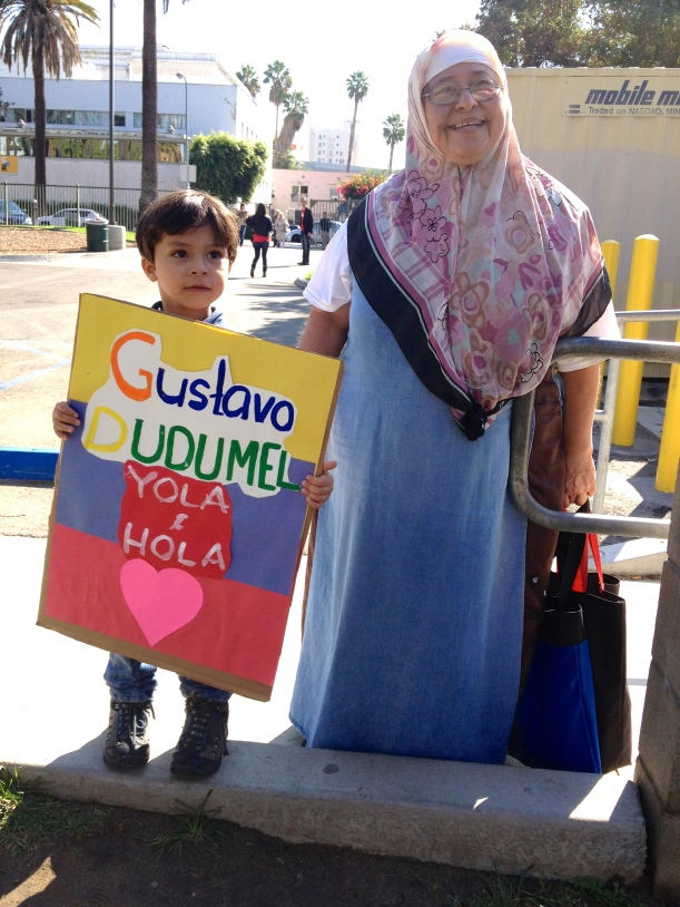 London and his grandmother come together to support their family and the community on our YOLA at HOLA 'Gustavo Dudamel Day'